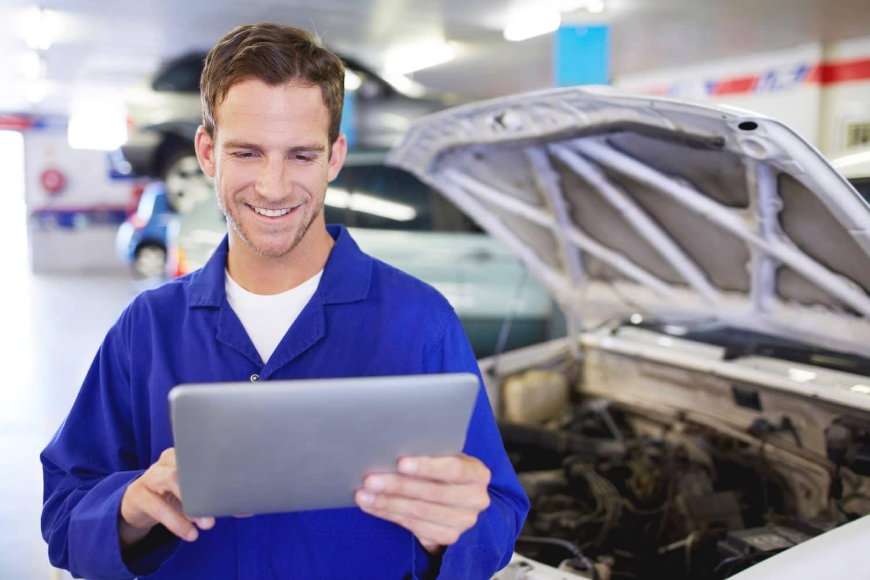 technician checks engine with checklist