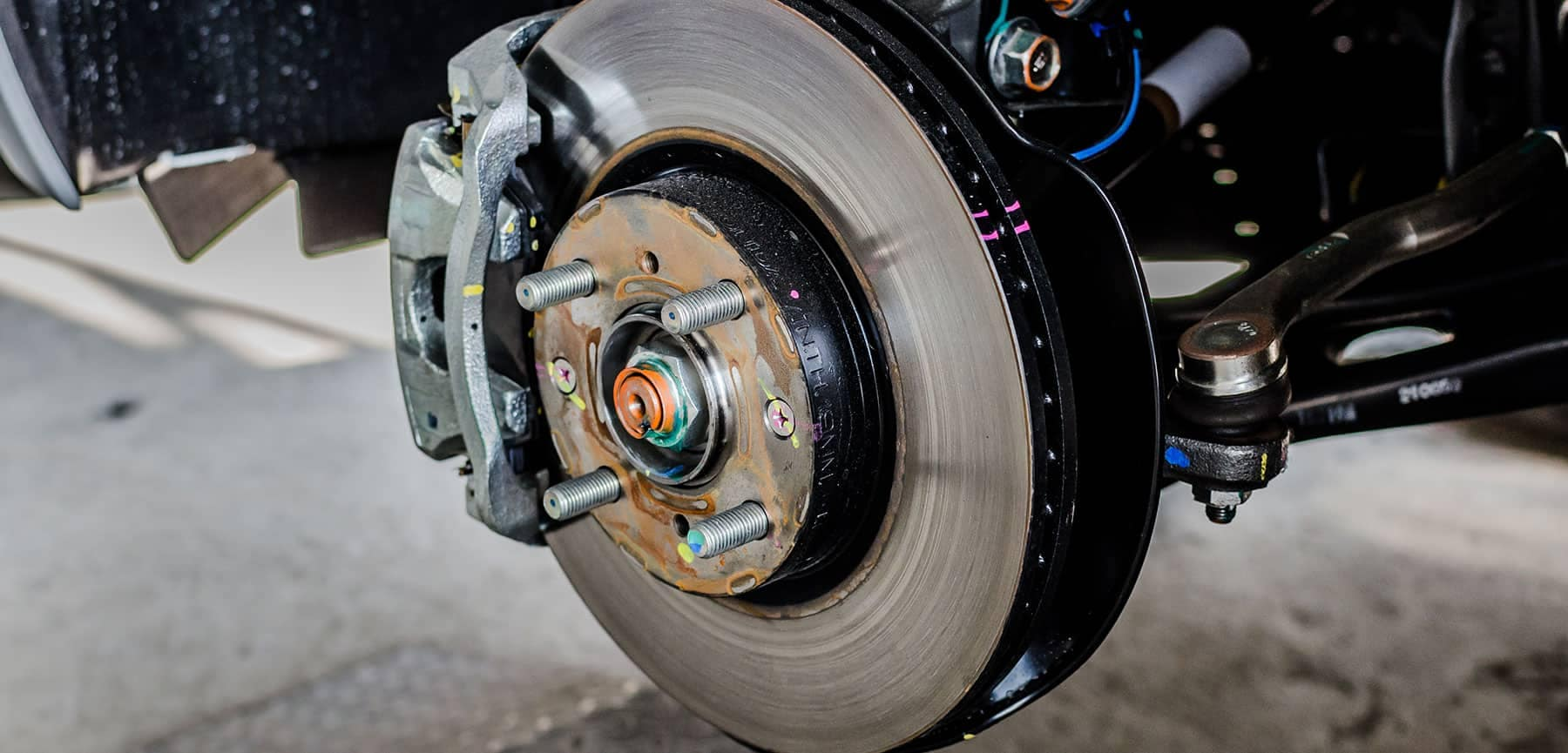 A closeup image of brake rotors on a vehicle