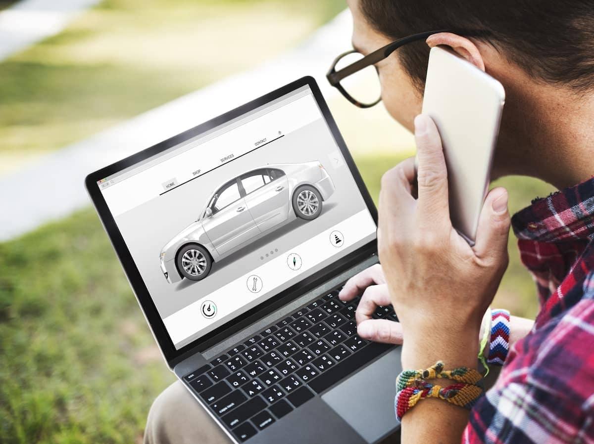 A man shopping a virtual showroom at an auto dealership