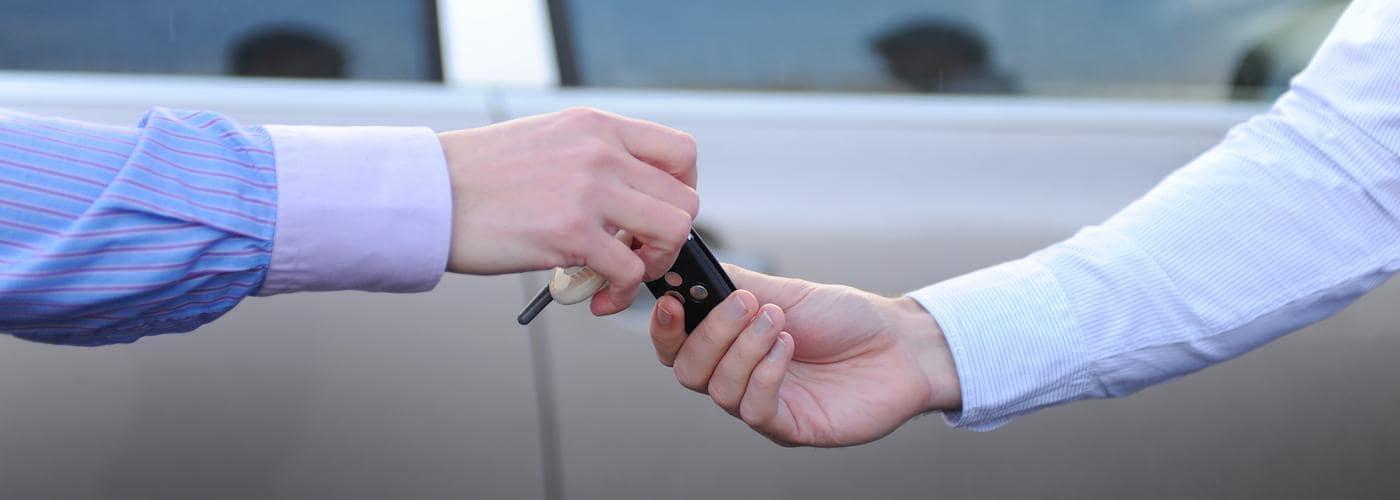 Finance banner exchanging car keys