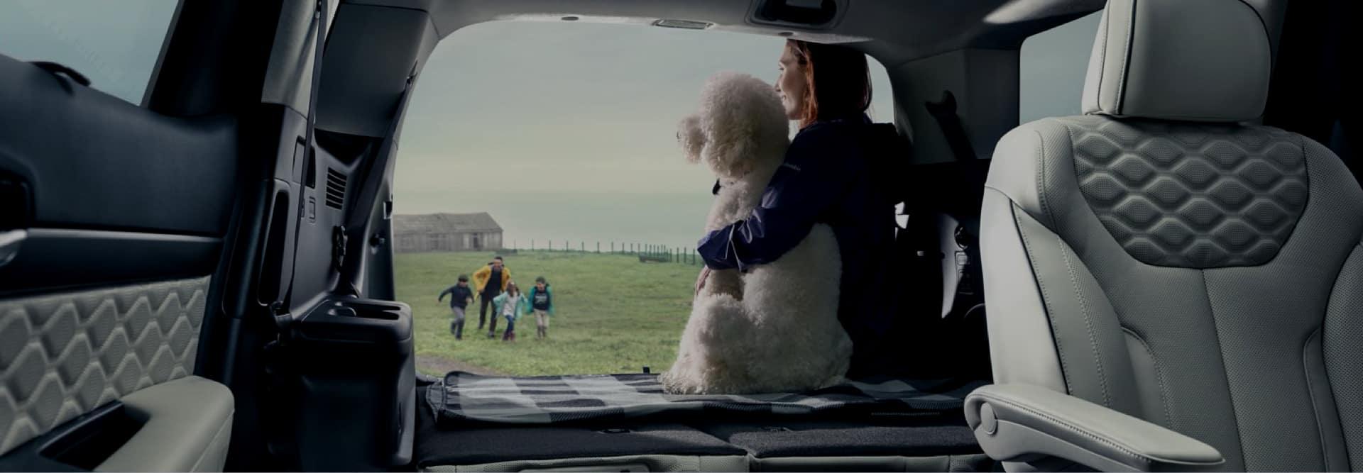 Family sitting inside SUV