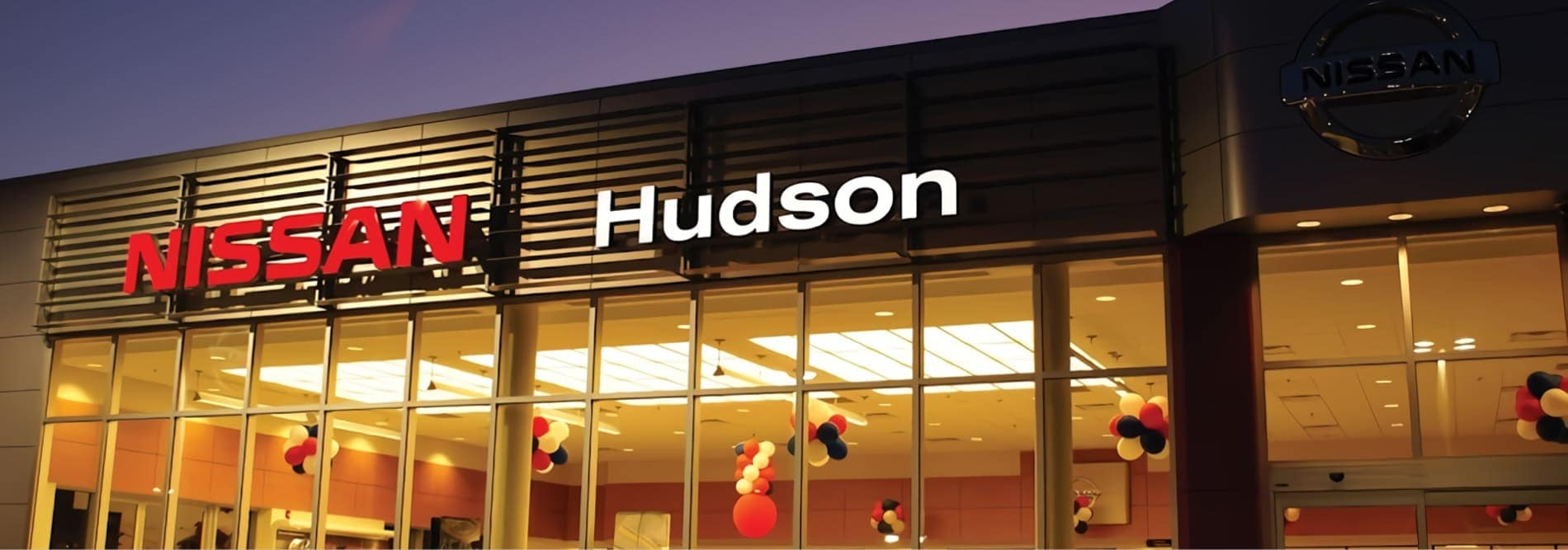 Night shot of Hudson Nissan dealership building