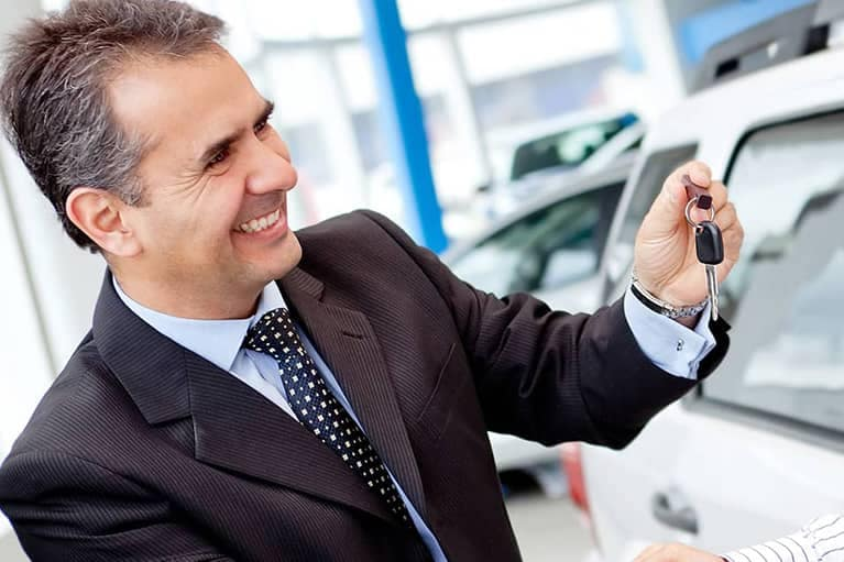 Service Advisor giving keys to customer