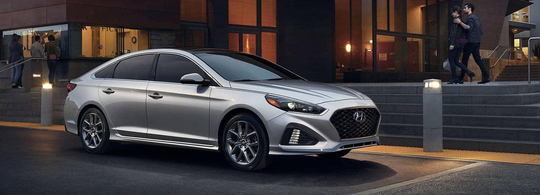 2019 Silver Hyundai Sonata parked in a modern area