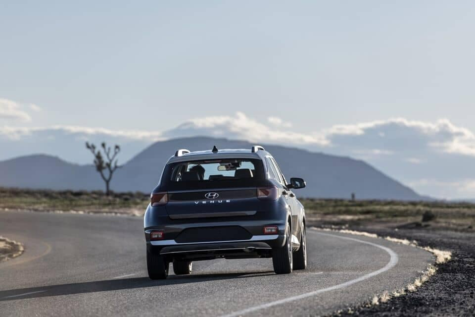 2021 Venue rear view driving on open road