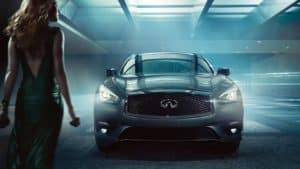 woman standing next to q70