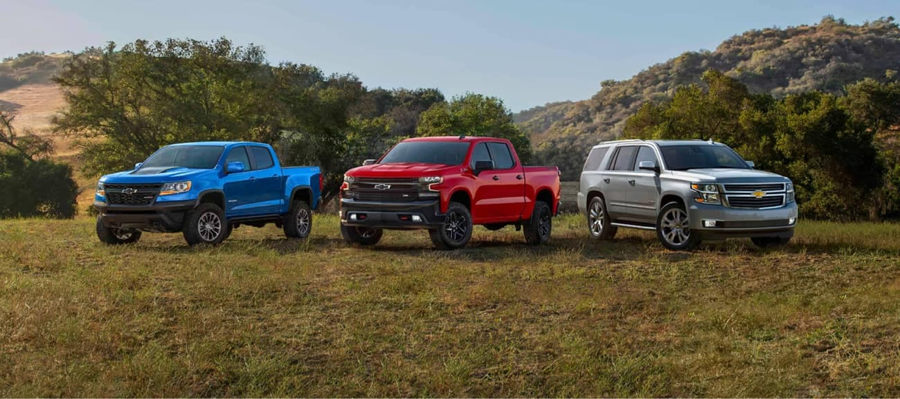 Chevrolet Truck and SUV Lineup - parked in a field