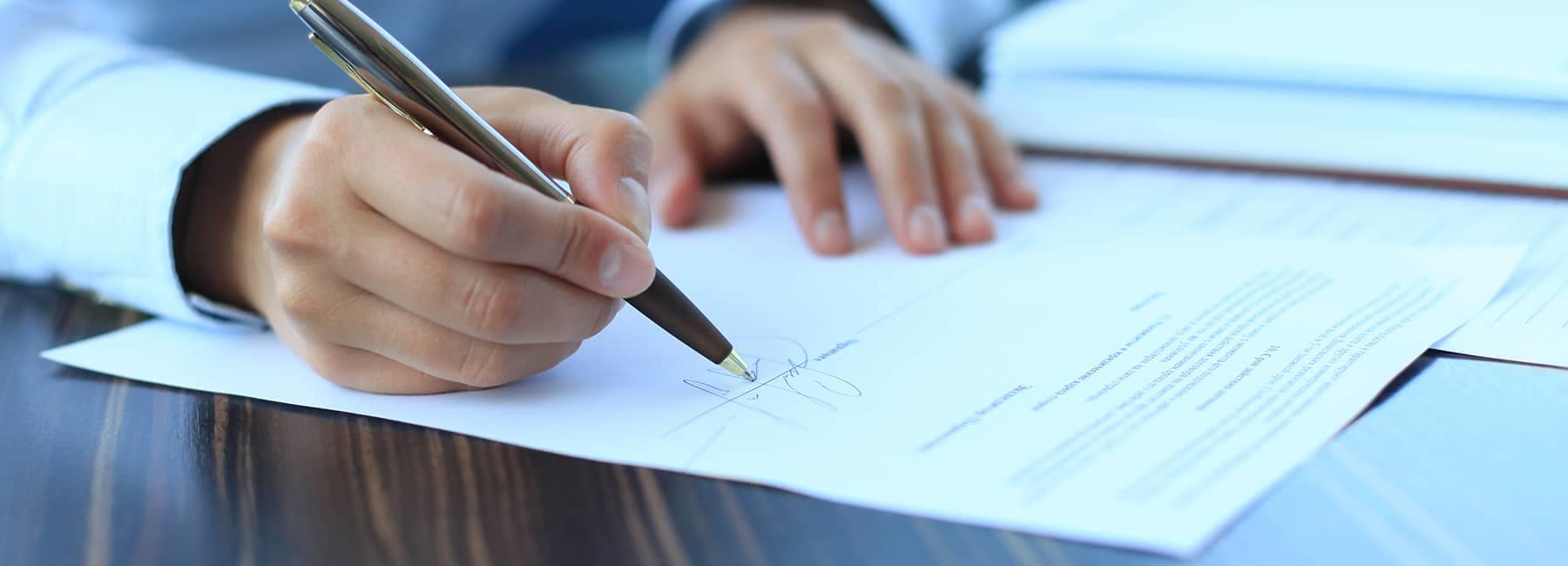person writing up contract