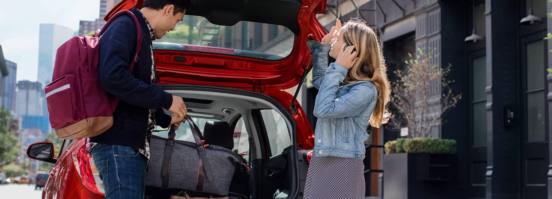 Red 2020 Chevrolet Spark with Open Hatchback