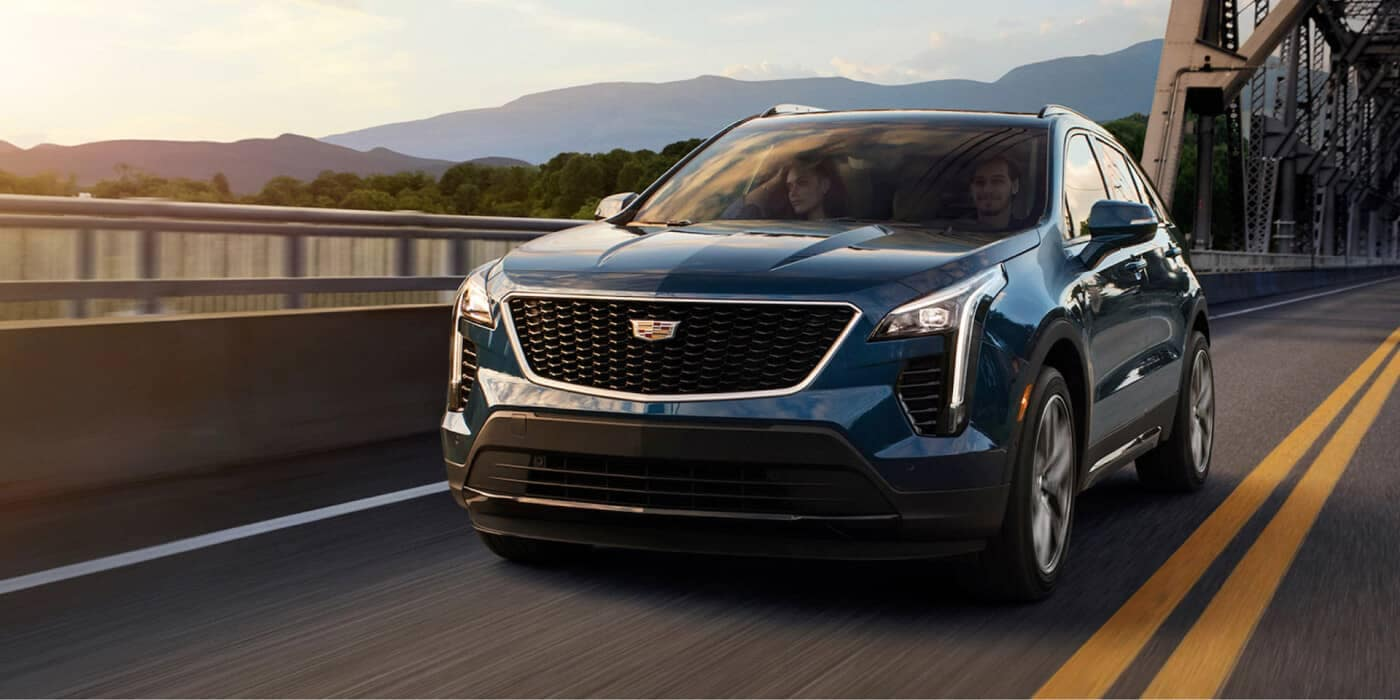 2020 Cadillac XT4 Driving over bridge at sunset