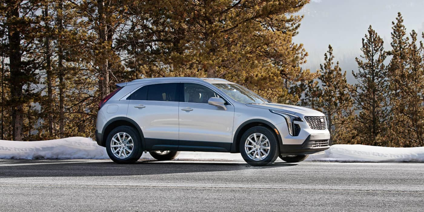 2020 White Cadillac XT4 parked on the road near snow