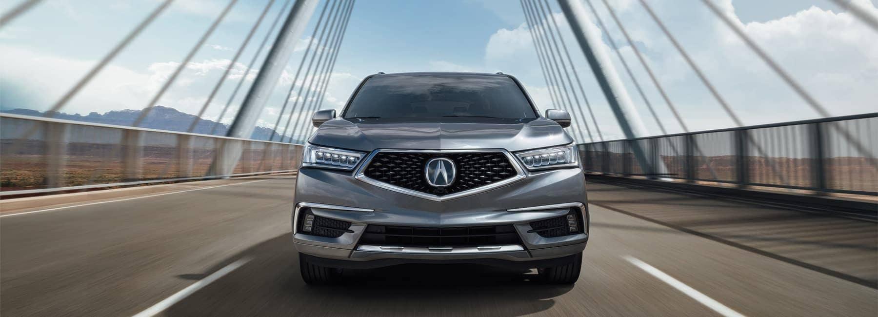 2020-Acura-MDX-under-modern-steel-metallic-bridge