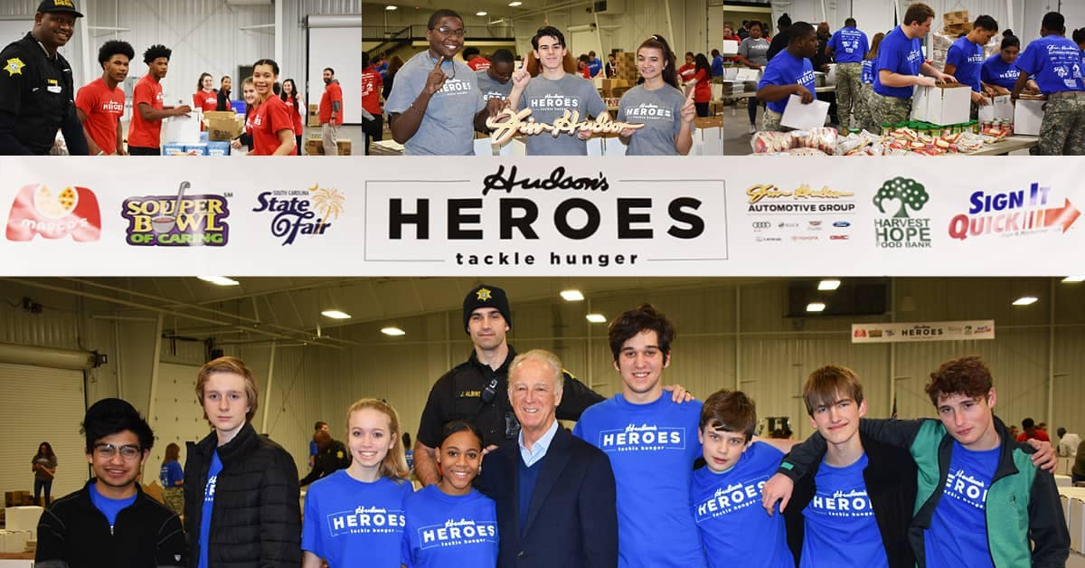 Hudson Heroes - group of people packing food for the needy