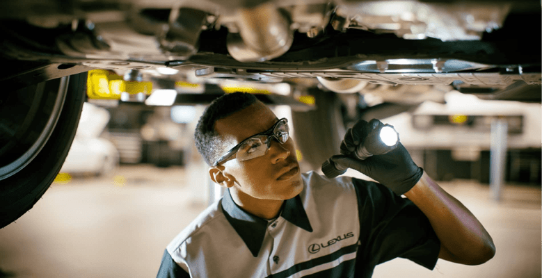 lexus technician looking under vehicle