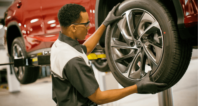 technician replacing lexus wheel
