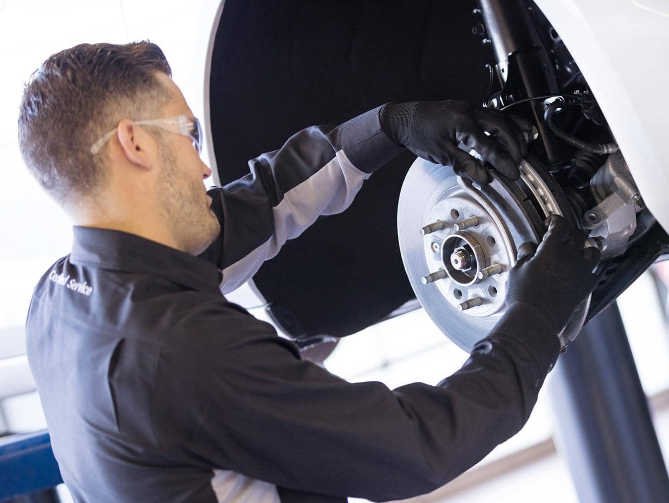 Chevrolet Service Technician installing new brakes