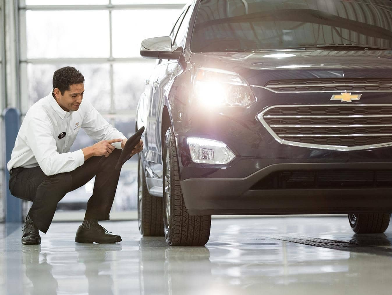 Chevrolet Service Technician inspecting new car