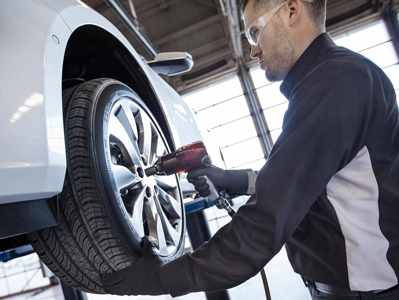 Chevrolet Service Technician putting new tire on car