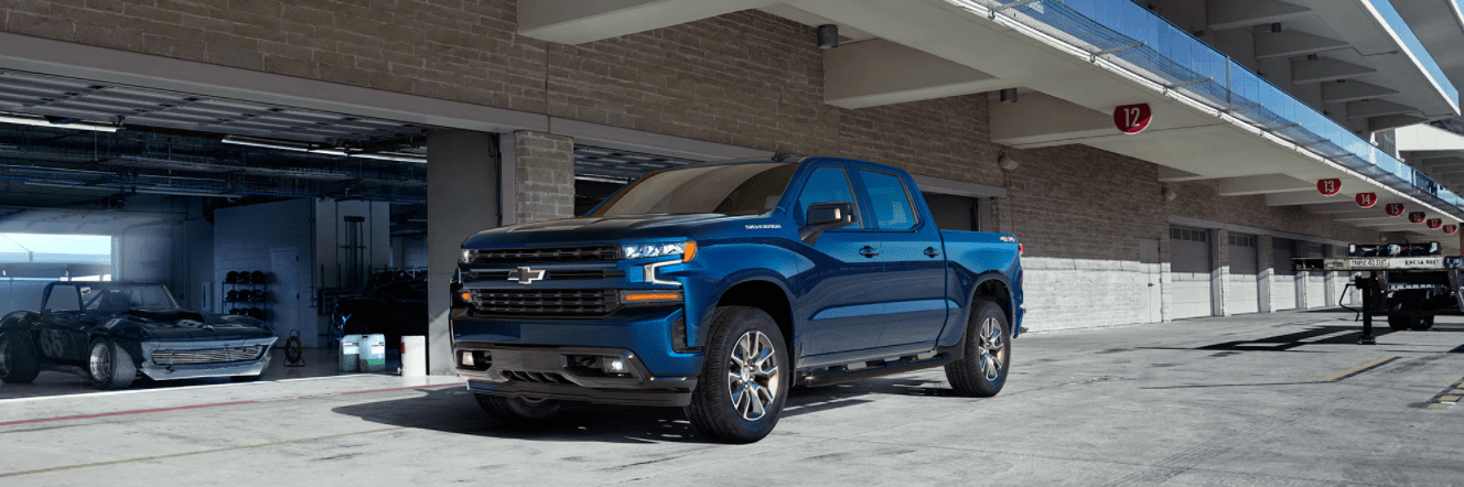 A 2020 Chevy Silverado purchased online parked outside of a garage