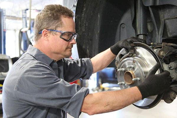 Brakes being replaced by a mechanic
