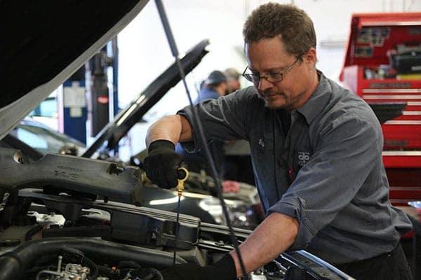 Mechanic doing an oil change