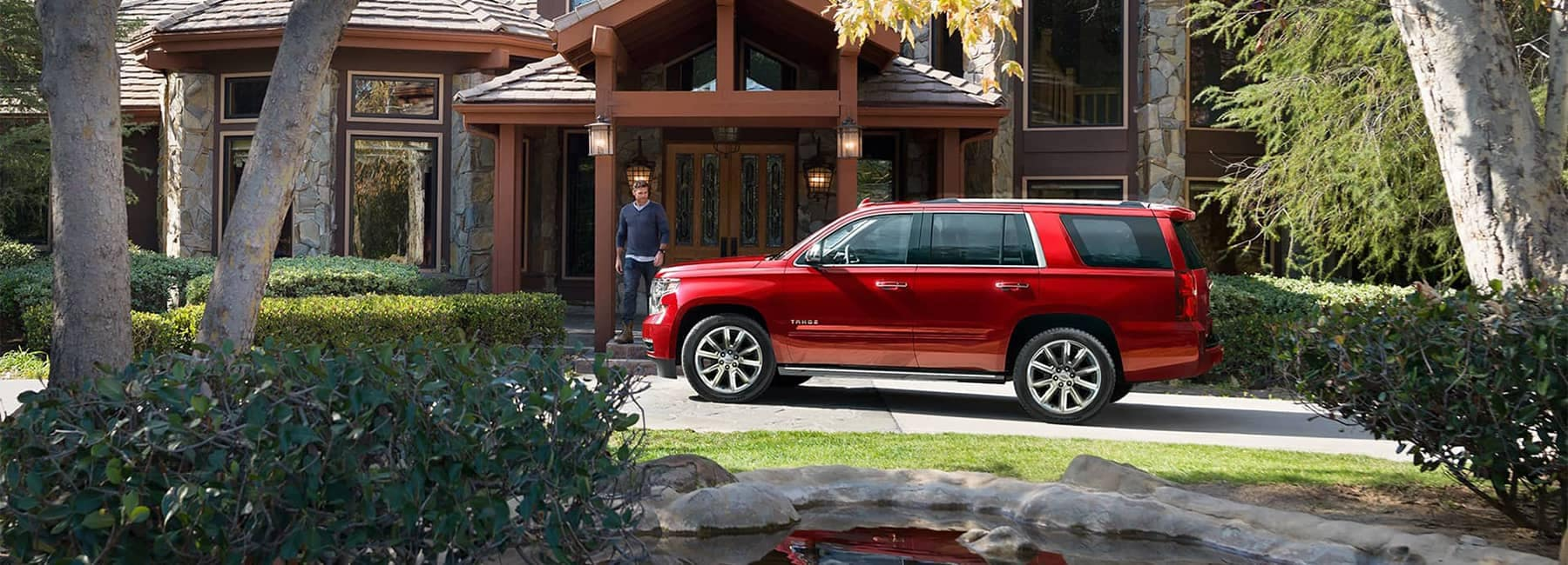 2019 Red Chevrolet Tahoe Parked in front of a House