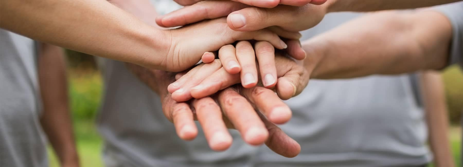 Close Up of Hands on Top of Other Hands