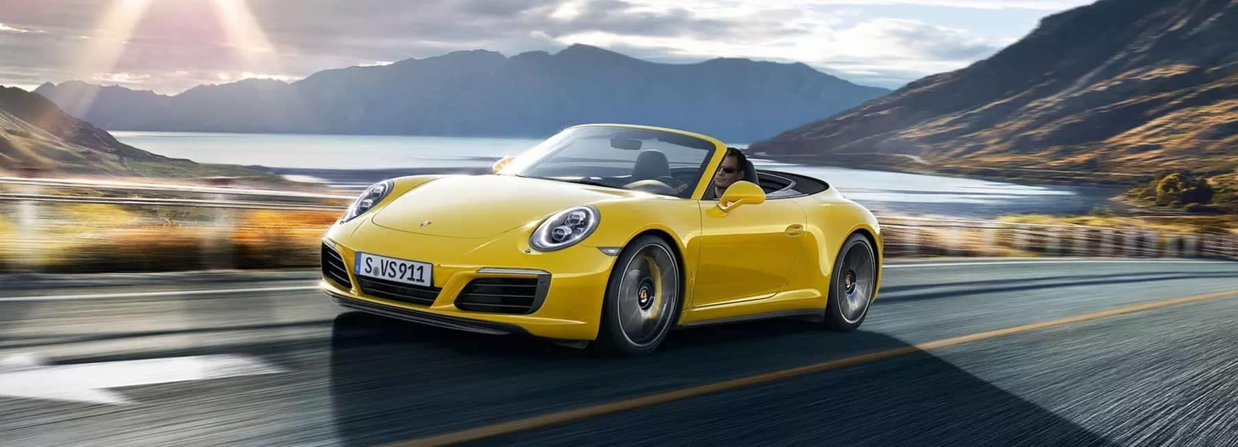 Yellow Porsche on highway