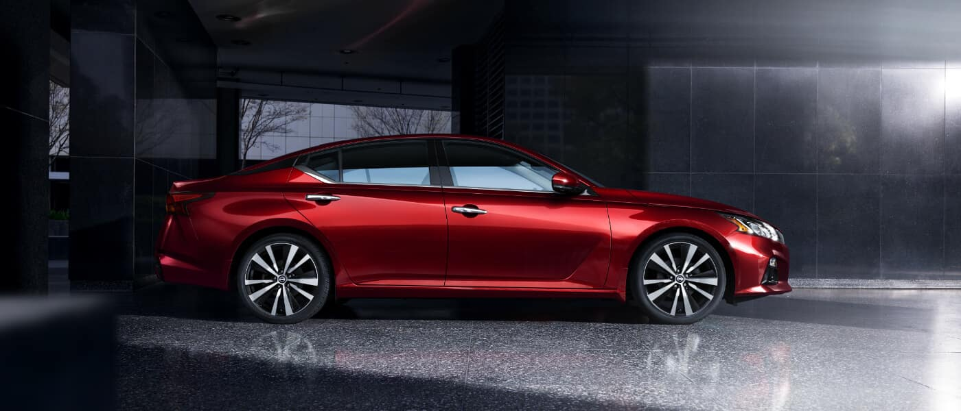 The side view of a red 2019 Nissan Altima