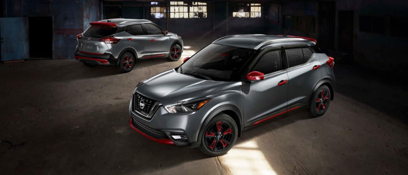 Two 2019 Nissan Kicks parked in a dark garage