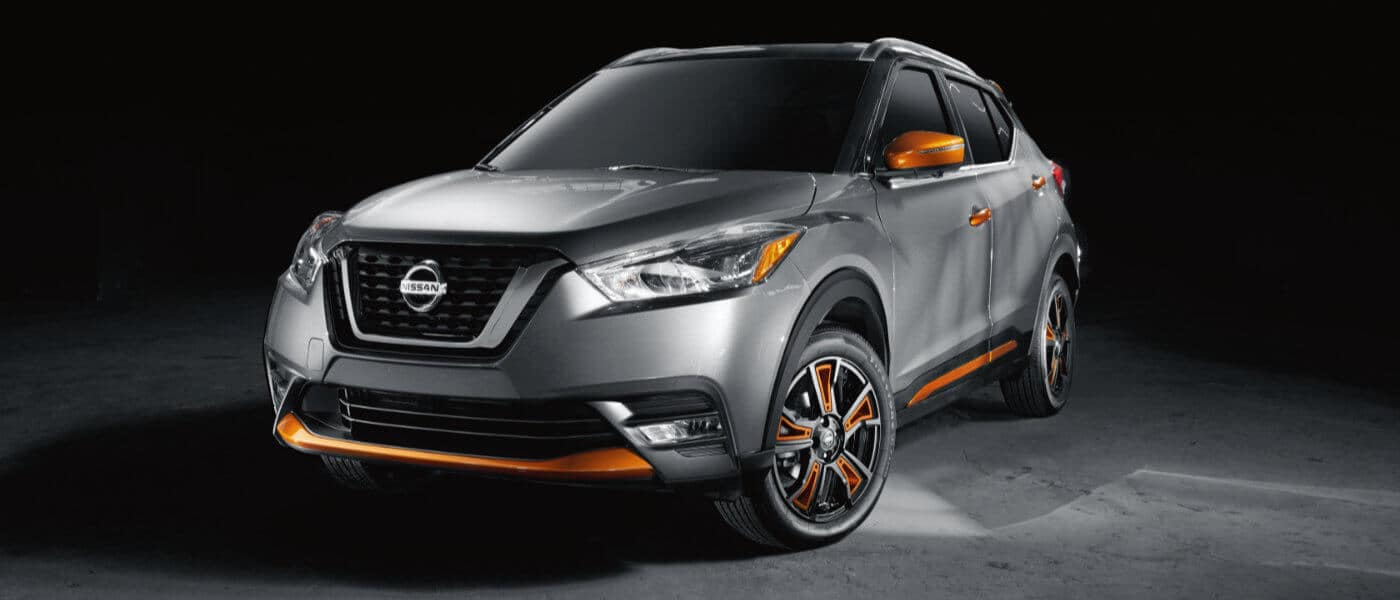 A silver and orange 2019 Nissan Kicks