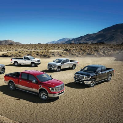 A ground of 2019 Nissan Titans parked in a desert landscape