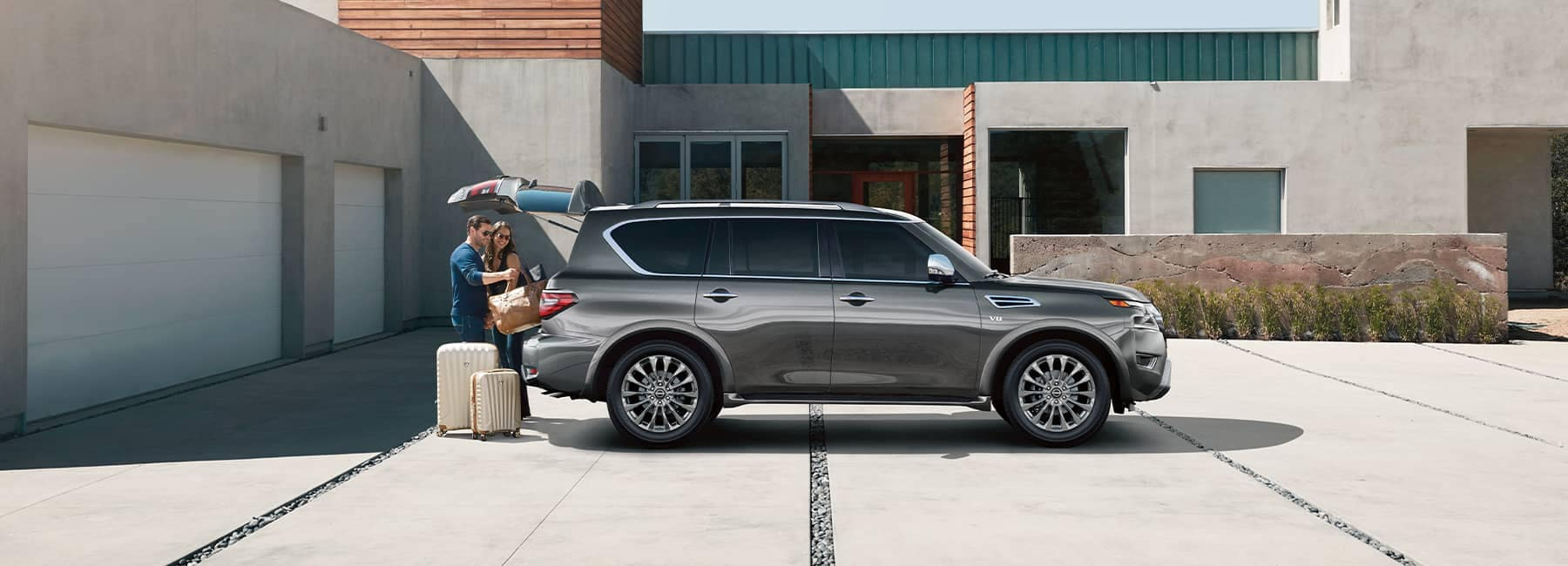 A 2021 Grey Nissan Armada parked in a driveway with the back open