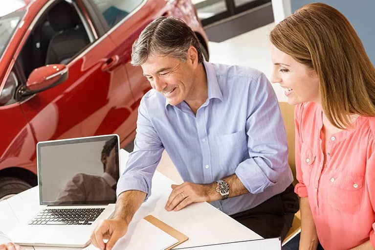 Couple Looking at Financial Documents with Salesman