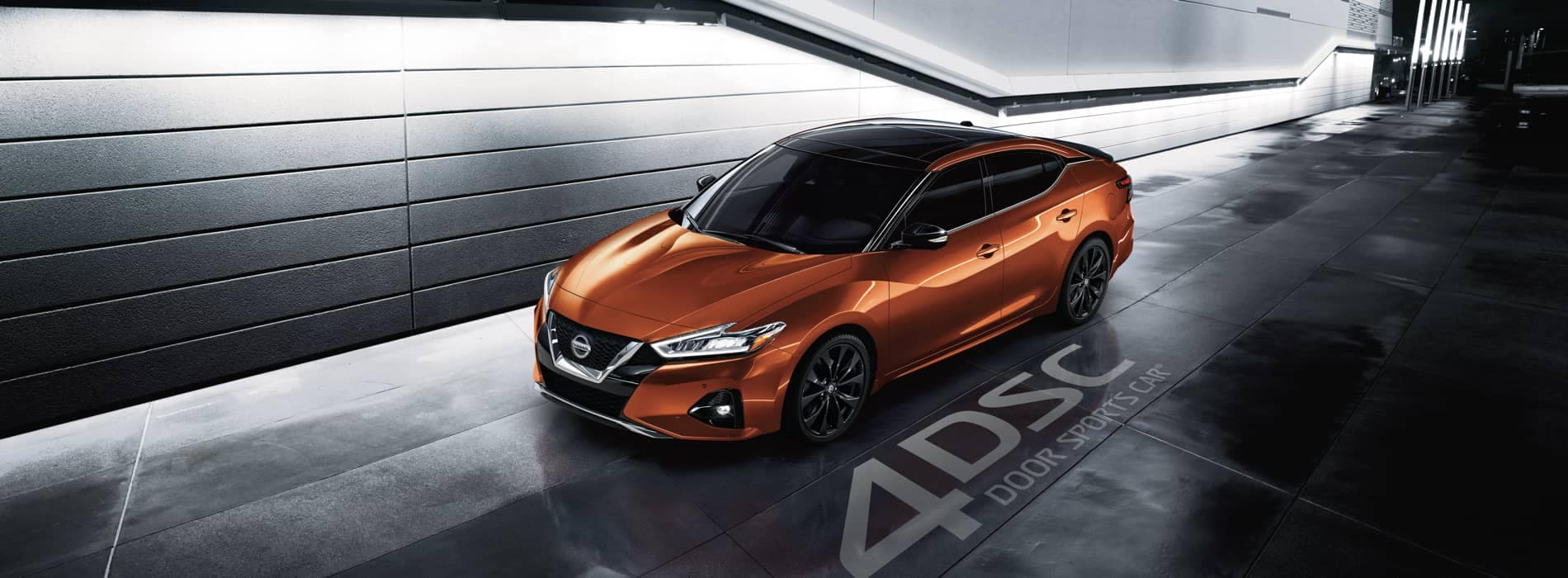 2020 Maxima parked by modern building at night