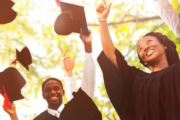 College graduates throwing hats
