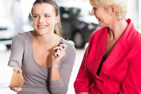 Two women in a dealership
