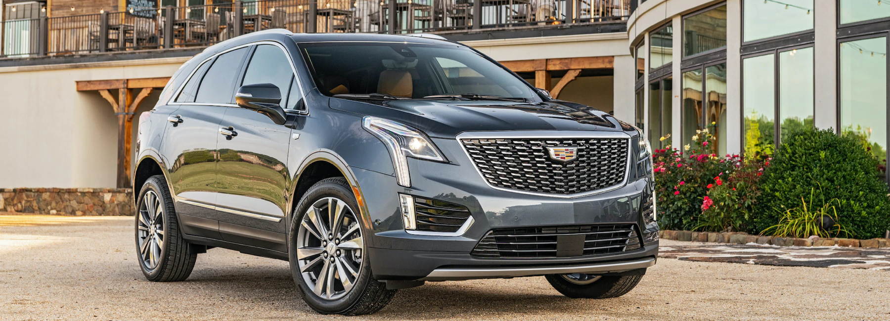 Cadillac XT5 parked on gravel driveway