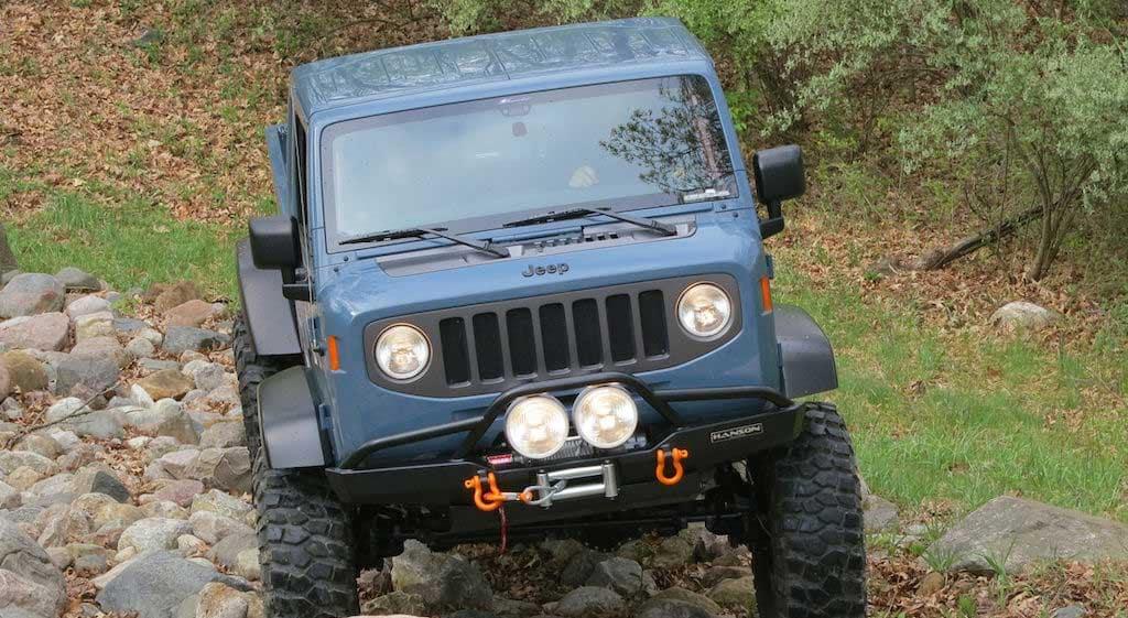 Jeep climbing over rocks