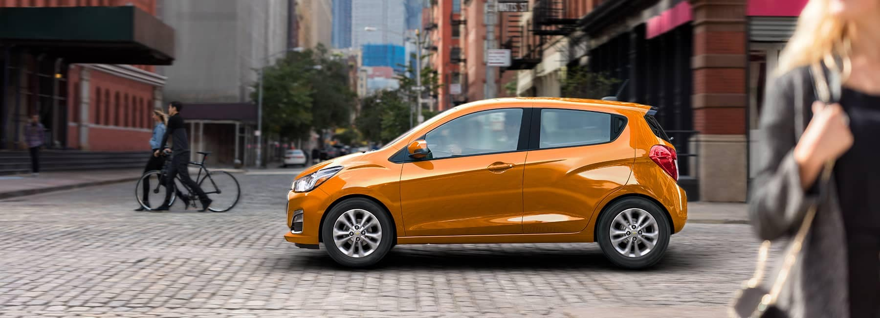 Orange 2020 Chevrolet Spark on a City Street_mobile