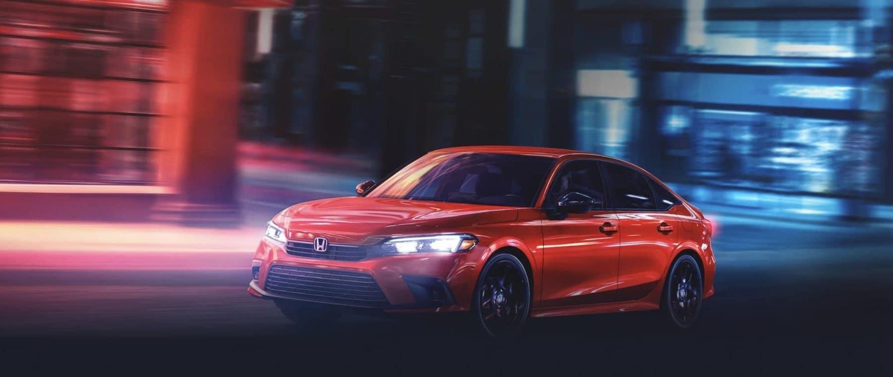 Red Honda vehicle driving at night