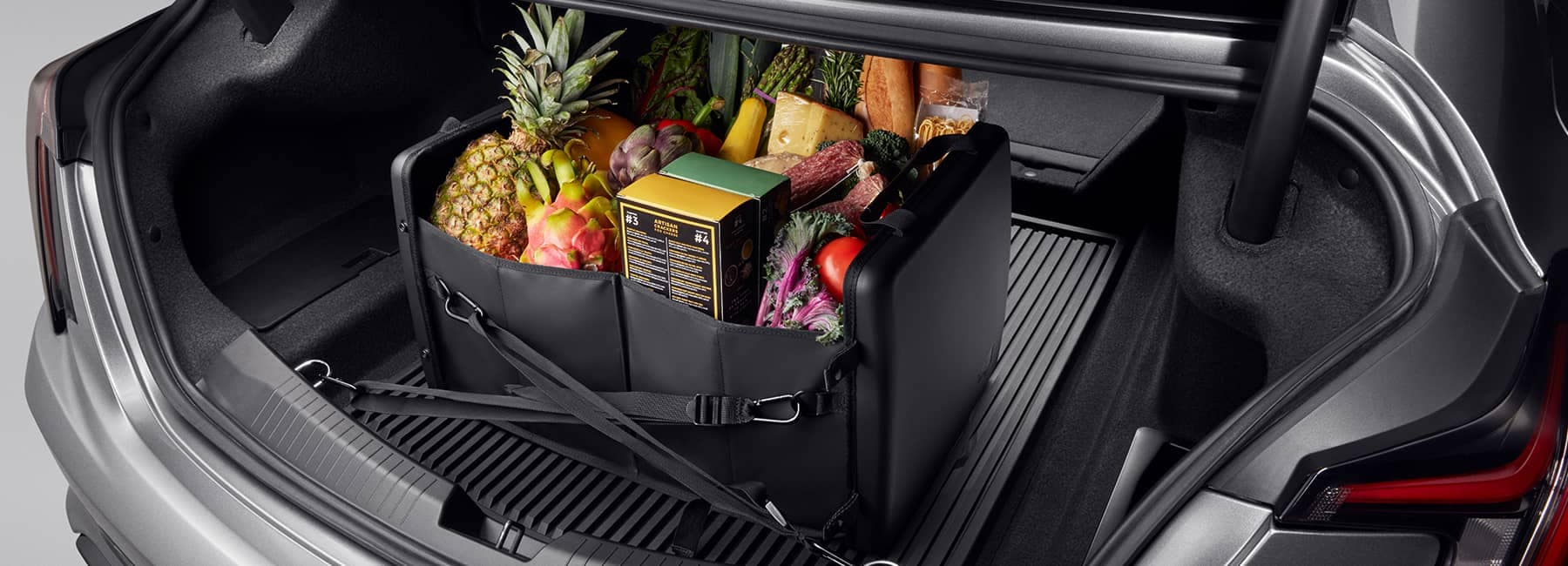 Cadillac Trunk Accessories Banner, Fruit and other goods from the grocery store secured in the trunk of a Cadillac Sedan