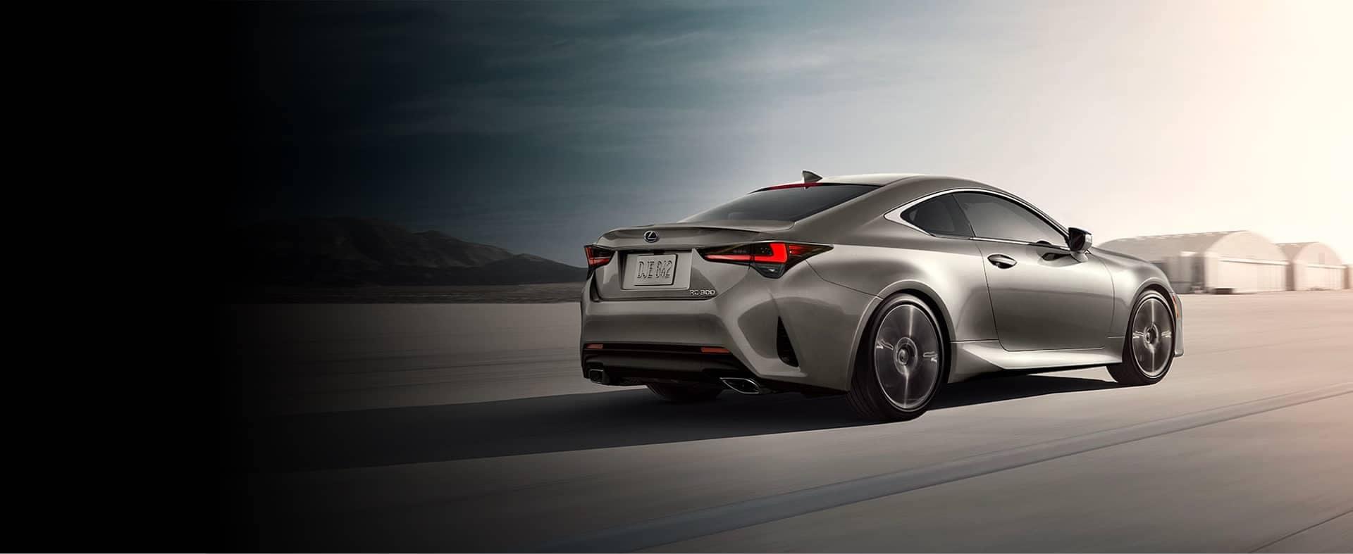 Gray Lexus Sedan driving away