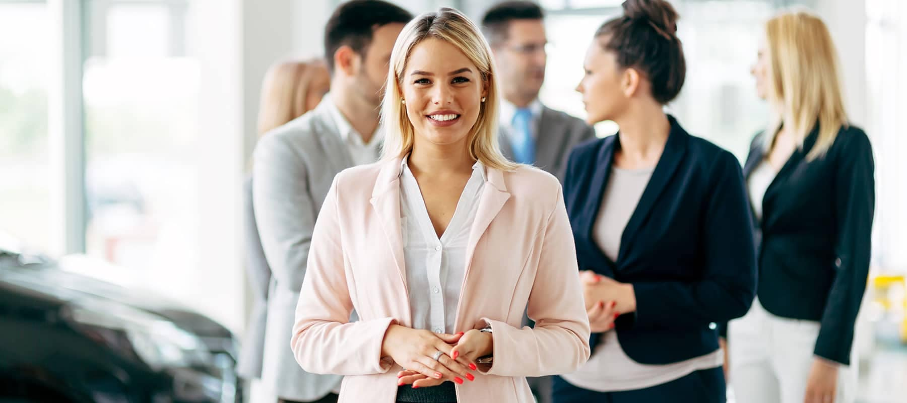 Business Woman Standing in front of People
