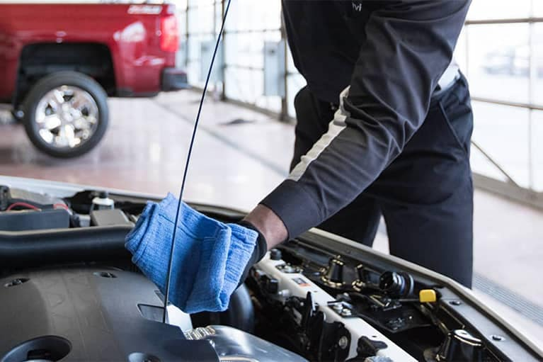 GM Certified Service Technician Checking Oil