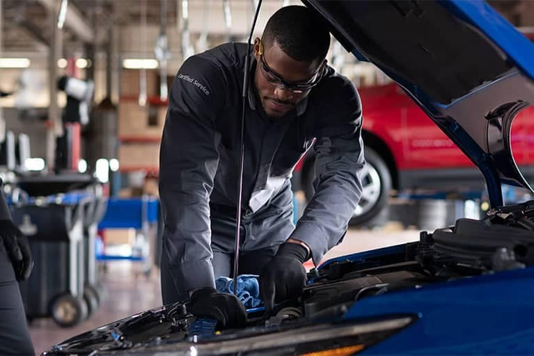 GM Certified Service Technician Working on the Engine Mobile