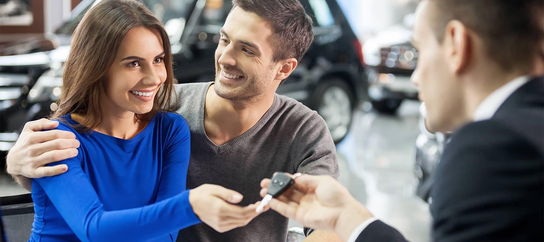 Salesman Handing Couple Keys