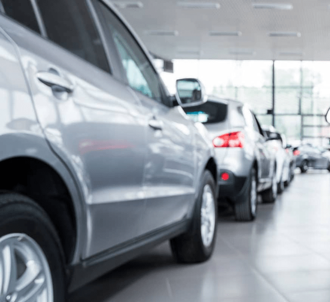 row-of-cars-in-showroom