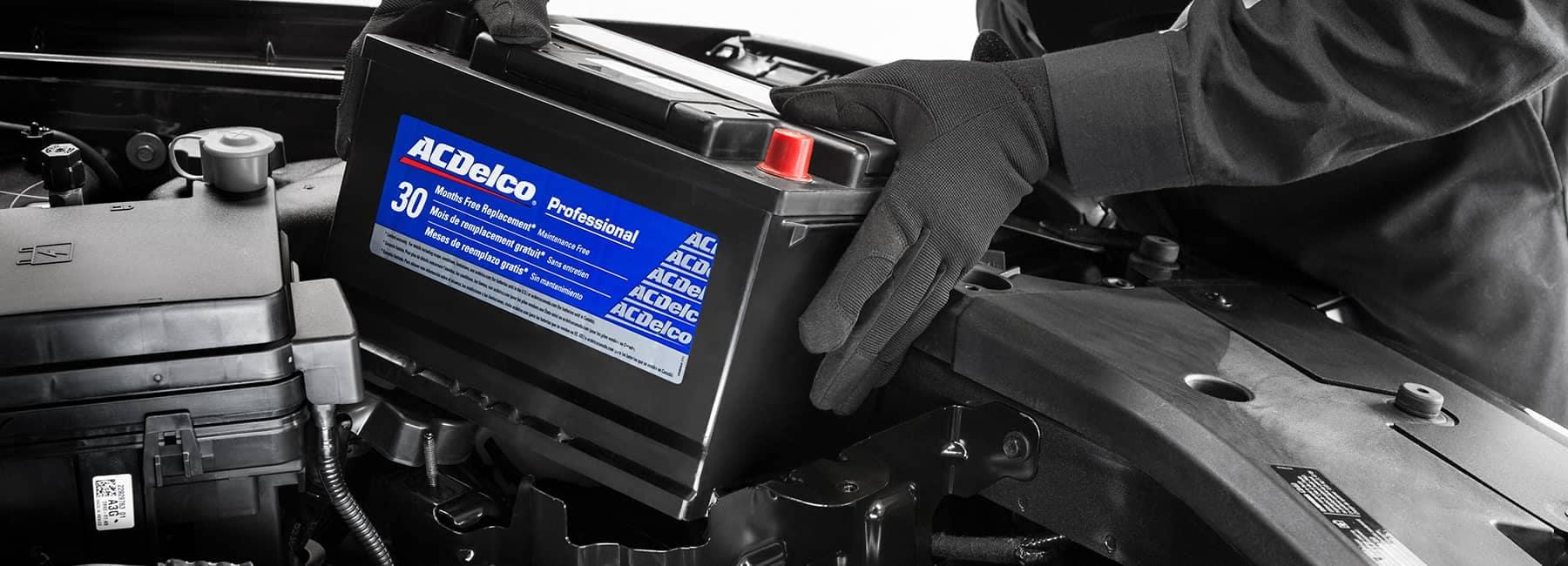 service technician installs AC Delco battery