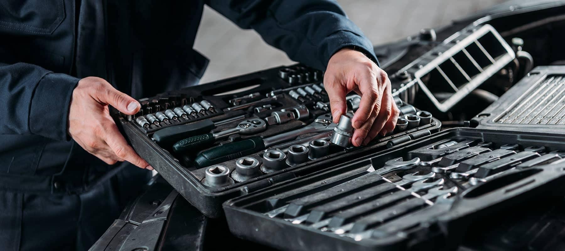 Mechanic Looking at Car Tools